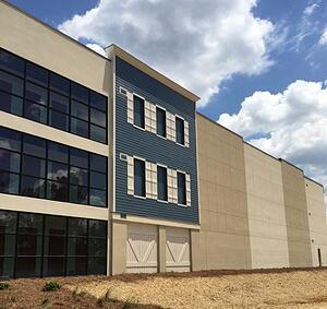self storage facility with windows and blue metal siding