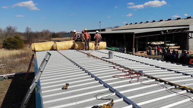 metal roof with insulation being installed